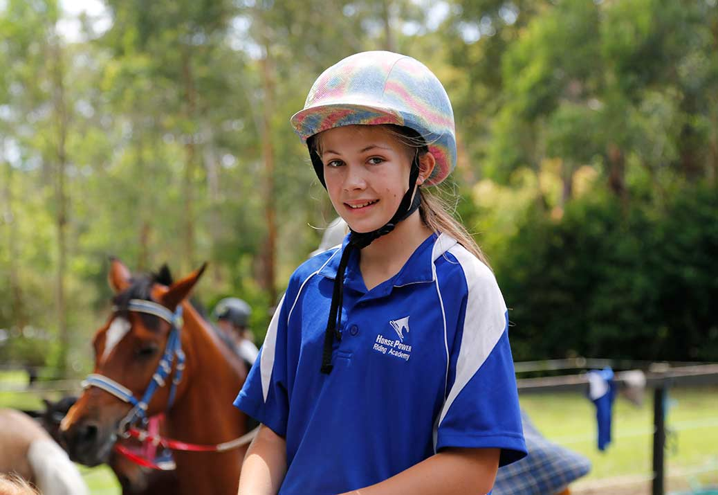 Maddison smiles as she has just mounted for her ride.