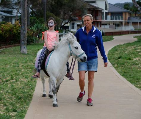 Sandie leads Emily on Rocky at the Ettalong Oyster Festival in November 2015.