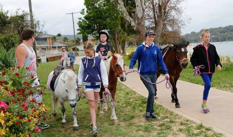 Sandie has trained a great team of capable horsepeople who help out at some of the events. Leading the ponies, from left, are: Jacy, Taz and Ashleigh/Maddison.
