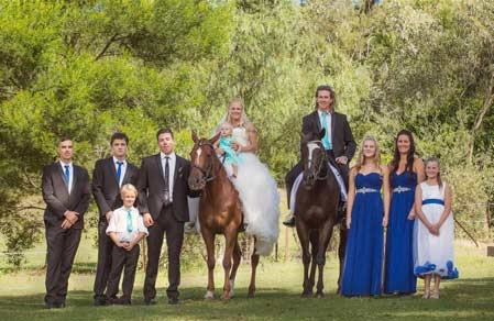 Bridal party with horses at HPRA. Photo © Jodie Andrews Photography.
