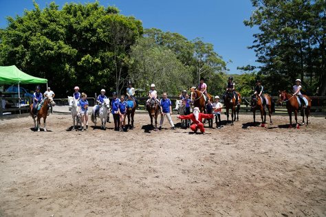 The riders, their mounts and Santa post for the camera after a happy day's riding.