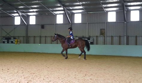 Sandie arranged riding in an indoor arena on rainy days during camp