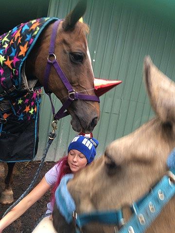 The girls dressed the horses in party hats to add to the spirit of Roxy's birthday party.