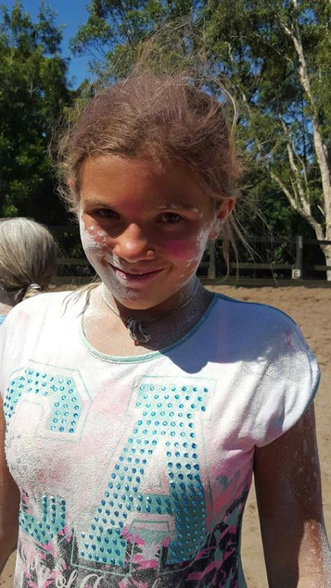 A happy face after a flour chucking game