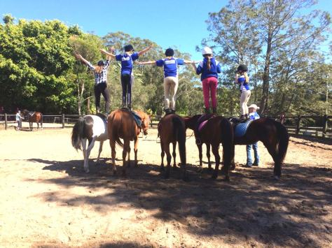 Students stand on HPRA ponies and horses to develop confidence and balance.