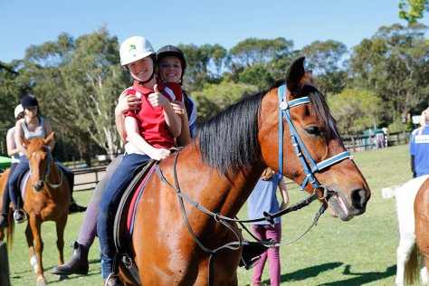 Two happy riders give the HPRA camp the thumbs up