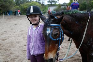 The smile on this rider says she made a lovely partnership with the bay pony, Trixie