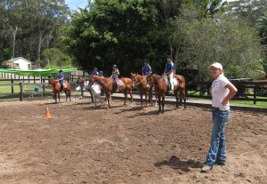 The riders lined up, and their instructor just before jumping commenced