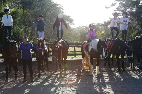 Standing on the horses' backs encourages trust and confidence in both riders and horses