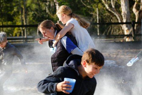 HorsePower kids enjoying the flour fight on the last day
